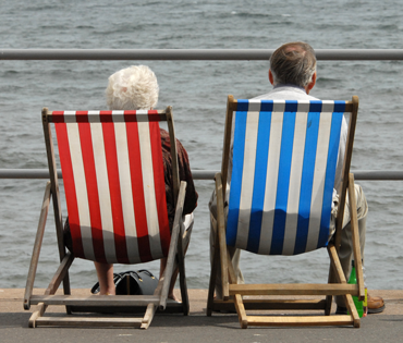 Photograph of couple sitting on deckchairs